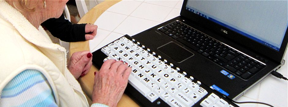 We have a large screen laptop and an extra-large keyboard with easy-to-read keys, which make it easier to type.